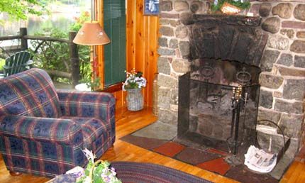 Algonquin Cottage Fireplace - Harbor Hill at Saranac Lake
